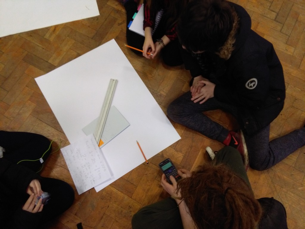 Students measuring the school hall to make scaled plan drawings